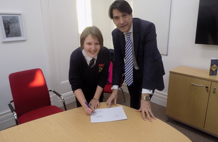 James Morris MP presents the competition winner, Abigail Palmer, with her prize
